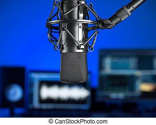 In the studio - Inside the music recording studio , focus on...