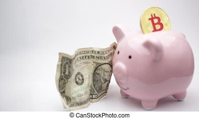 the piggy bank and bitcoin - in the white background and...