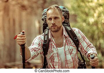 Nice handsome man holding a walking stick