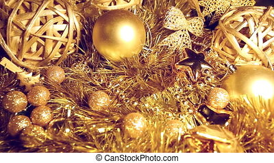 In tinsel and Christmas balls of gold color the female hand...