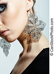 In vogue - Gorgeous woman wearing fantasy earrings