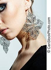 Gorgeous woman wearing fantasy earrings