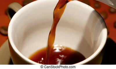 In white cup of poured hot black coffee. Closeup - In pure...
