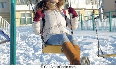 In winter park girl on a swing 4k