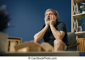 Old bearded man with alzheimer desease - Inability to...