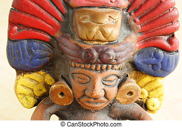 Colorful figure of native Peruvian god