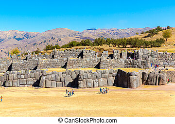 Inca Wall in SAQSAYWAMAN, Peru, South America. Example of polygonal masonry. The famous 32 angles stone in ancient Inca architecture.