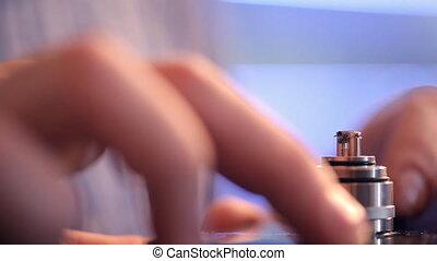 Incandescence metal coils on an e-cigarette closeup. Heating...