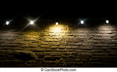 Incandescent and led bulbs on brick wall