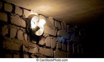 Incandescent Bulb Lights Off or Up on a Stone Wall -...