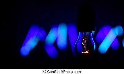incandescent lamp against the background of concert, dance...