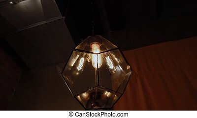 Incandescent lamp in the plafone on the wall. - Incandescent...