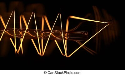 Macro shot of powerful incandescent lamp tungsten filament