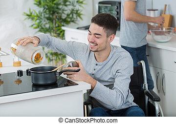 incapacitado, cadeira rodas, homem, jovem, cozinha