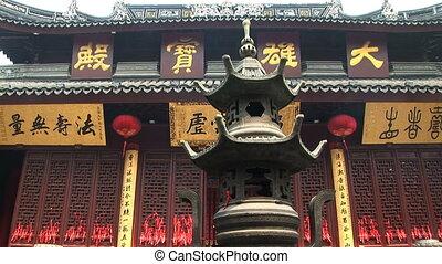 Incense Burner - Bronze incense burner in front of the Jade...