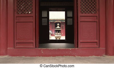 Incense Burner through Doorway - Bronze pagoda incense...