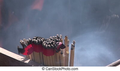 Incense Burning at Lama Temple - Burning incense offering at...