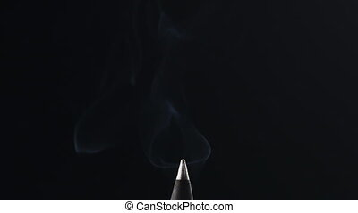 incense cone burning in slow motion over black background, 180fps prores footage
