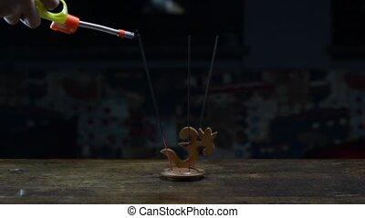 incense and Yoga symbol Om