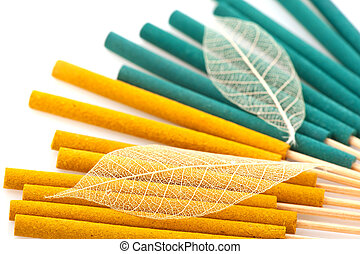 Incense - Green and yellow incense on white background