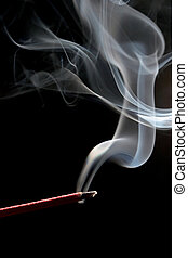 incense over black - incense stick with smoke trail shot...