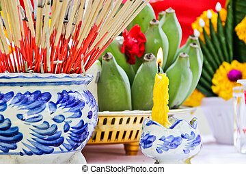 Incense pot and Candles burning