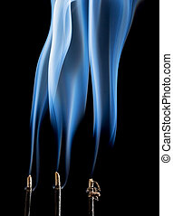 incense smoke abstract - delicate smoke plumes from three...