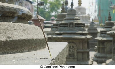 Incense smoldering in ancient Sawayambhunath monkey temple in Kathmandu, Nepal