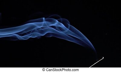 Incense stick are burning and smoke on black...
