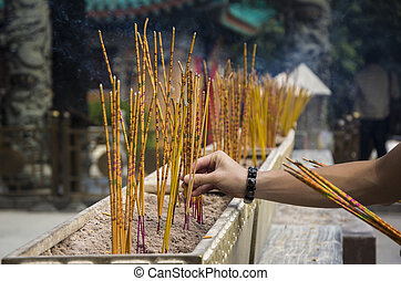 Yellow incense sticks burning at a Taoist temple of Wong Tai Sin, Hong Kong.