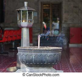 The joss sticks burning in big joss stick pot at the chinese