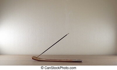 Incense sticks in a bowel on a wooden table with incense...