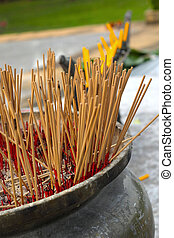 Incense sticks in an altar at temple