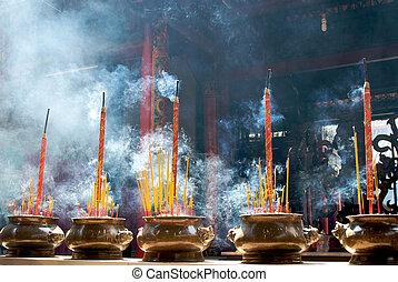 Incense sticks in pagoda - Smoking prayer sticks in copper...