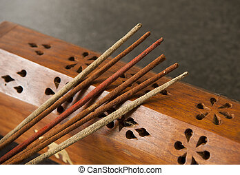 Incense Sticks - Incense sticks against a timber box