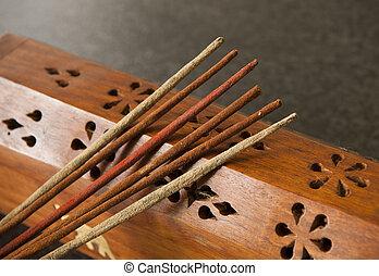 Incense Sticks - Incense sticks against a timber box