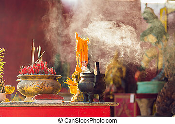 Incense sticks in woman hand  use for pray respect to the
