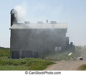 Burnable trash is disposed of in this continuously operating incinerator, suitable for a small town of about 200 people.