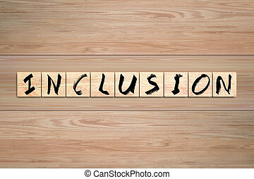 Inclusion word written on wood box.