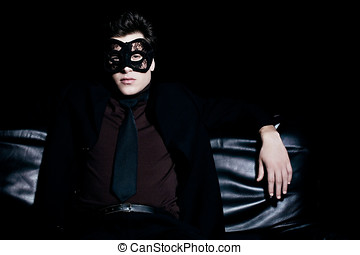 Incognito Boss - Man in black suit and lace mask.