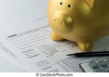 Income tax - Filling income tax form with pen, calculator...