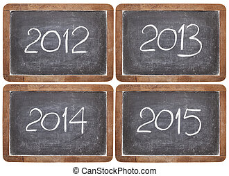 current and incoming years, 2012, 2013, 2014, 2015 on vintage slate blackboards, isolated on white