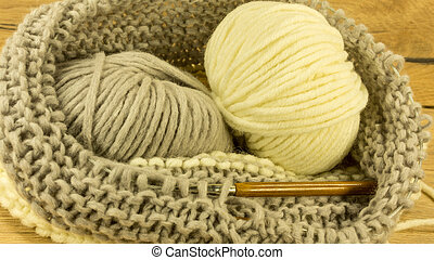 Incomplete knitting project with a woolen ball