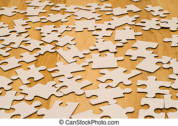 Incomplete Puzzle - An incomplete puzzle shot against a...