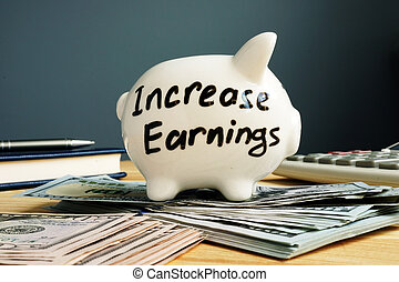 Increase earnings concept. Piggy bank and cash.