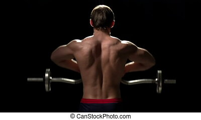 Increase Muscular Bulk - Bodybuilder with his back to the...