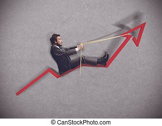 Increase of economy - Businessman rides towards the increase...
