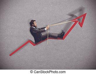 Businessman rides towards the increase of economy
