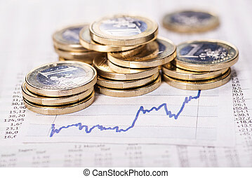 Increasing exchange rate - Euro coins and curve graphic as a...
