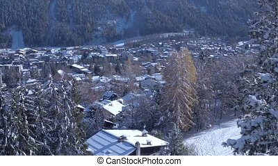 Incredible aerial drone view on small luxury resort village cozy villas in pine tree winter forest in Alps mountains